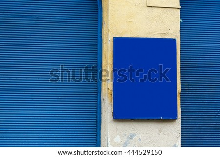 blue sign board and wooden window, front advertising board, space for text, Budapest city street, travel concept - stock photo