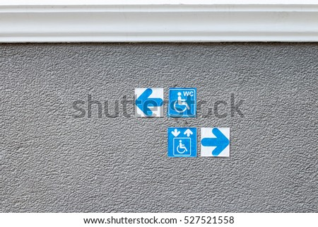 blue sign indicating on wheelchair usage on steel ramp for disabled people.