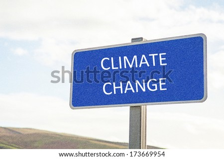 Blue sign with Climate Change in text and added weather effect - stock photo