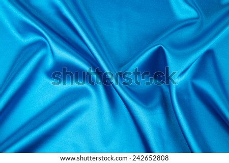 Blue silk drapery. Isolated as a whole background.  - stock photo