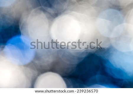 Blue silver blur circle lights as background. - stock photo