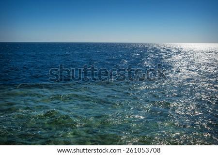 Blue simple clean seascape sea view in horizon. - stock photo