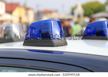 Blue sirens of police car while patrolling in the city - stock photo