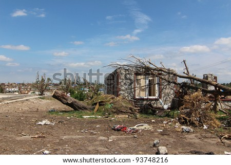 Blue skies expose the extensive damage caused by an EF5 tornado of historic proportions. - stock photo