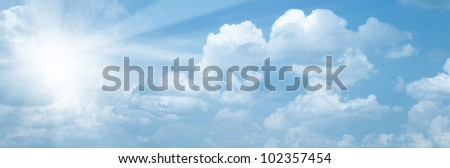 Blue skies with bright sun as abstract backgrounds - stock photo