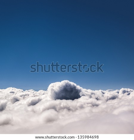 Blue sky above  the clouds. Copy space. - stock photo