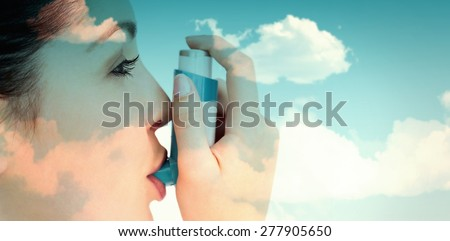 blue sky against woman with an asthma inhaler - stock photo