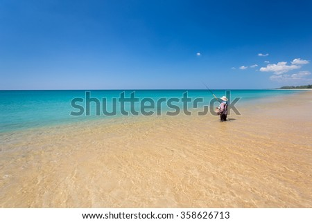 Blue sky and calm Andaman sea on Mai Kao beach in Phuket Thailand