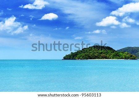 Blue sky and clear water at Langkawi beach, Malaysia. - stock photo