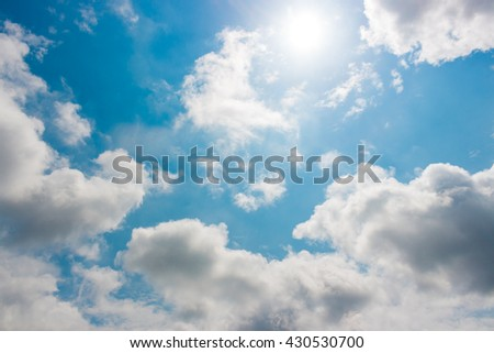 Blue sky and cloud against the sunlight. For abstract background or insert text copy space. - stock photo