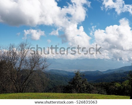 Blue sky and cloud among nature with tree and mountain