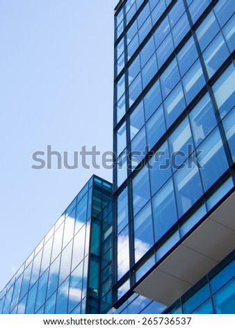 blue sky and cloud reflection on the windows of an office building