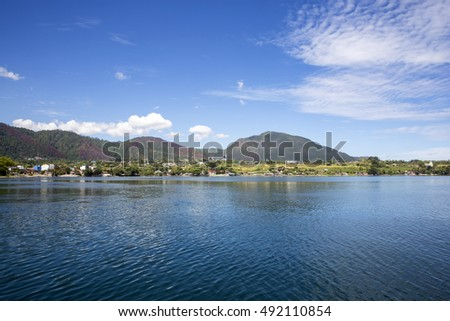 blue sky and clouds in Lake Toba,, with a beautiful view of the hills around Lake Toba,taken from ships