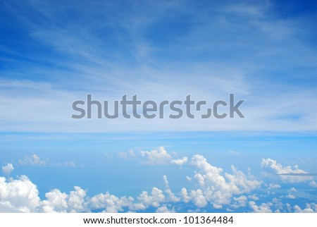 Blue sky and Clouds looking through window window of the Airplane - stock photo