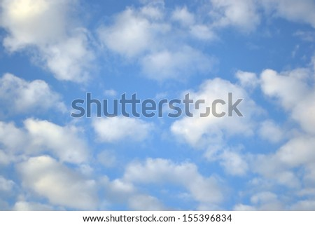 Blue sky and clouds, may be used as background. - stock photo