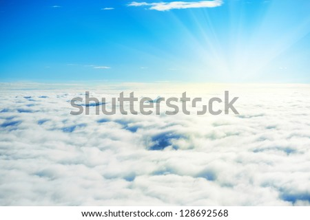 Blue sky and clouds. Plane view above the earth, can be used for background - stock photo