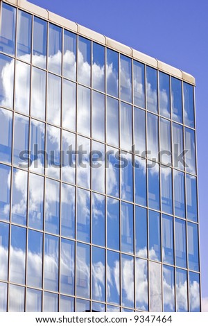 Blue sky and clouds reflected in the glass building