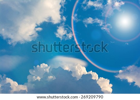 Blue sky and clouds with Rainbow Around the Sun. - stock photo