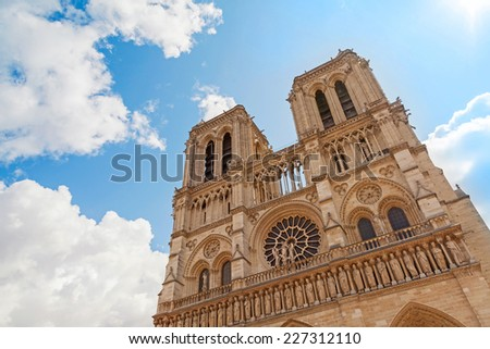Blue sky and facade of Notre Dame de Paris cathedral, France
