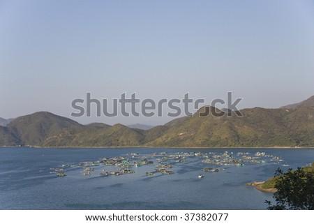 Blue sky and fishing Village in Sai Kung, Hong Kong - stock photo