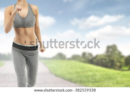 blue sky and green grass with fast woman