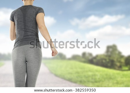 blue sky and green grass with sport time and slim woman