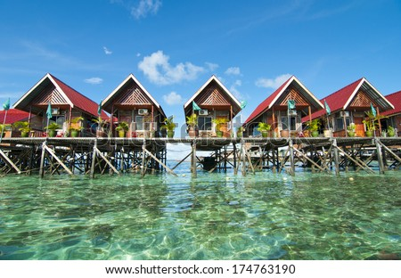 blue sky and green sea view from mabul island lodge - stock photo