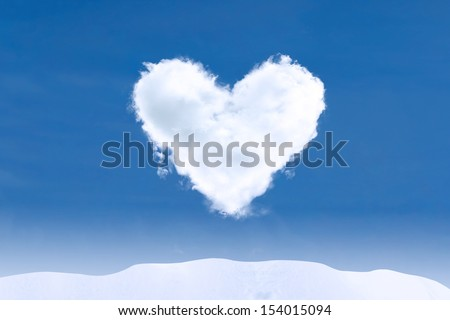Blue sky and heart shape cloud on winter day