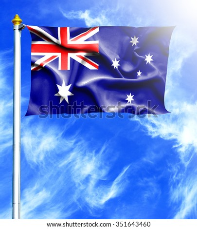 Blue sky and mast with hanged waving flag of Australia