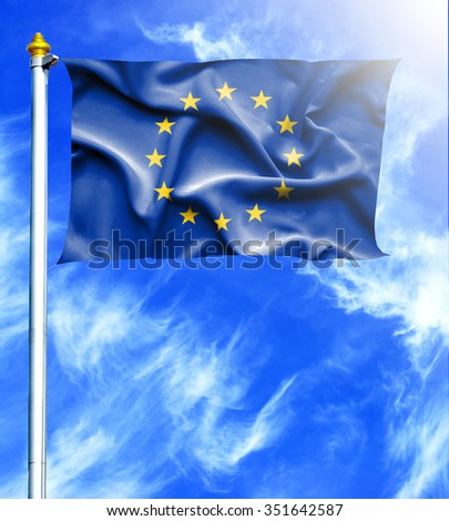 Blue sky and mast with hanged waving flag of European Union