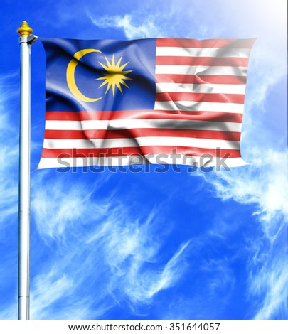 Blue sky and mast with hanged waving flag of Malaysia