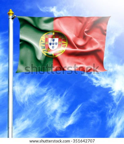 Blue sky and mast with hanged waving flag of Portugal