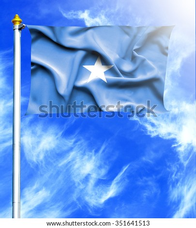 Blue sky and mast with hanged waving flag of Somalia