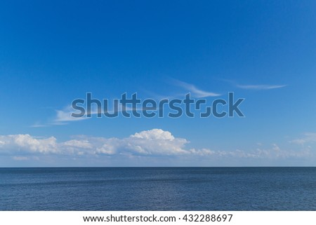 blue sky and sea, white cirrus clouds