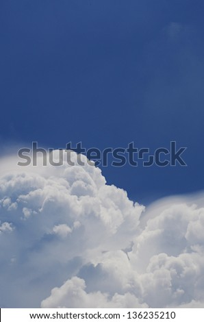 Blue sky and white cloud in strong sunny day. - stock photo
