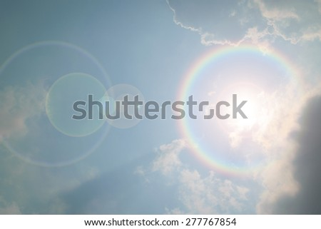 Blue sky and white cloud with sun light and corona - stock photo