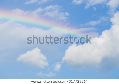 Blue sky and white cloud with sun light and rainbow - stock photo
