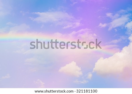 Blue sky and white cloud with sun light and rainbow in pastel color. - stock photo