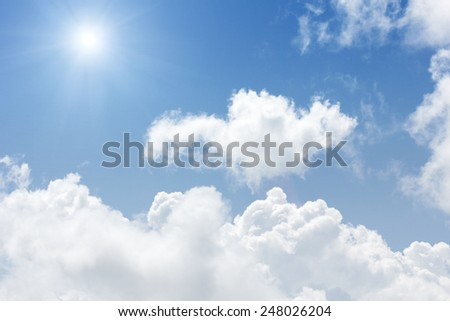 Blue sky and white clouds. - stock photo