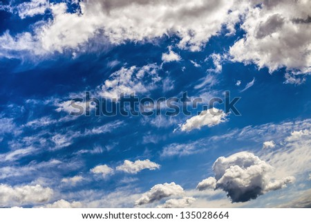 Blue Sky and White Clouds above - stock photo