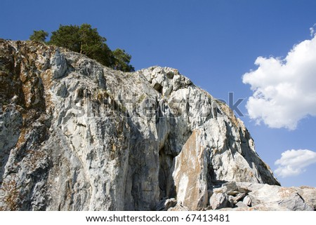Blue sky and white clouds above rock