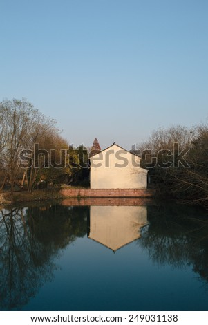 blue sky and withe house in xixi wetland,hangzhou,china - stock photo