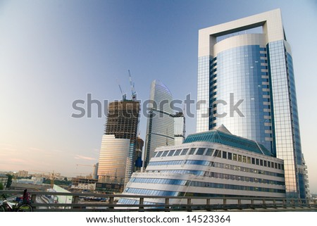 Blue sky at sunrises in city and high-rise buildings under construction.