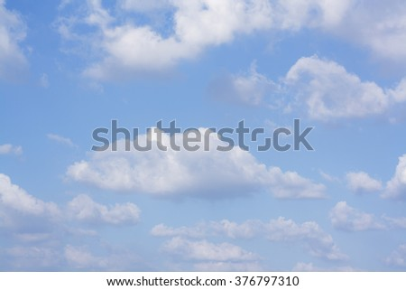 blue sky background with fluffy clouds - stock photo
