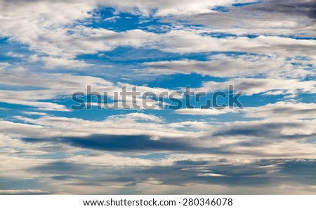 Blue sky background with rainbow and bright sun - stock photo