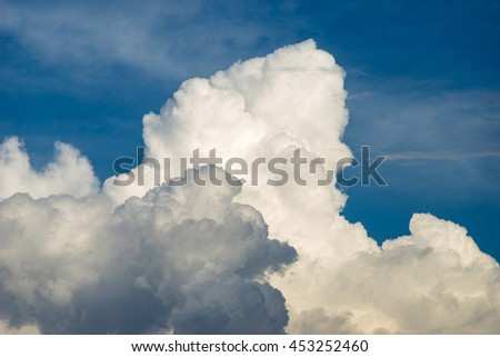 Blue sky background with scenic fluffy clouds - stock photo