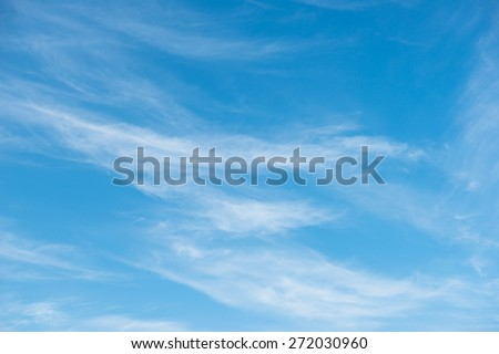 Blue sky background with soft white clouds  - stock photo