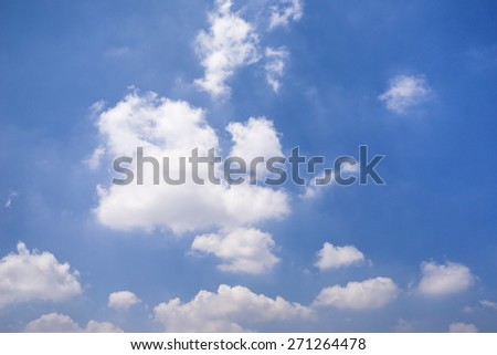 Blue sky background with white clouds. - stock photo