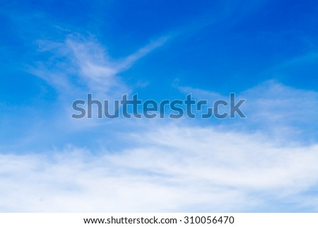 Blue sky background with white clouds.Blur or Defocus image. - stock photo