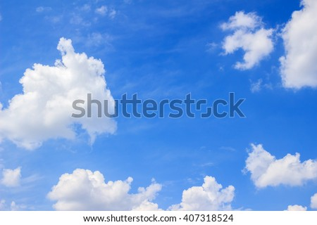 Blue sky background with white fluffy clouds - stock photo